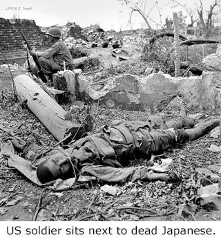 1944soldiersitsnexttodeadenemy-320